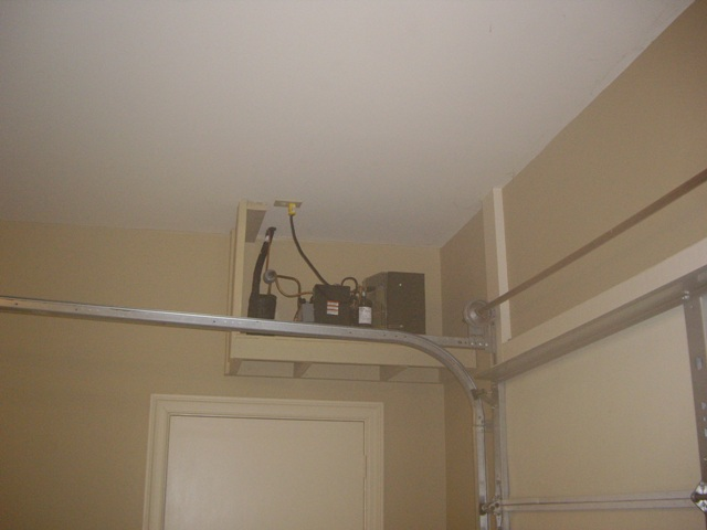 Rack mounted wine cellar cooling unit installed in baton for Garage wine cellar
